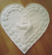 Trapunto technique heart pillow