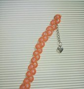 orange bracelet - unknown web