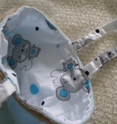 Blanket, bag and matching nappy pouch by Merriebabies